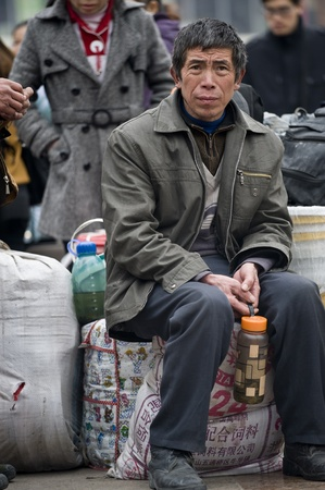 CHENGDU,CHINA -JANUARY 29: The unnamed man to leave the city to go home, Chengdu, January 29, 2011, Chinese New Year, the Chengdu Railway daily delivery of 200 000 people