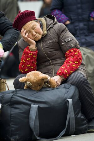 CHENGDU,CHINA -JANUARY 29: The unnamed elderly to leave the city to go home, Chengdu, January 29, 2011, Chinese New Year, the Chengdu Railway daily delivery of 200 000 people