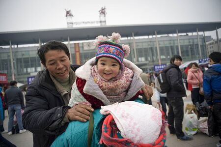 CHENGDU,CHINA -JANUARY 29:Unknown family left the city home, chengdu, jan. 29,, the New Year, chengdu railway 200000 passengers every day