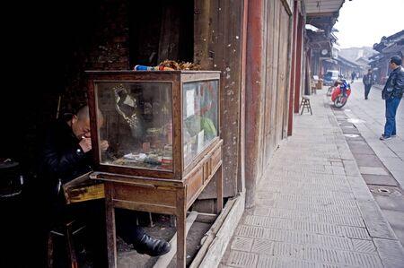 SICHUAN,CHINA-FEBRUARY 17:Urban renewal, farmers lose arable land, switching open clocks repair shop , February 17, 2011,sichuan,china Stock Photo - 12768862