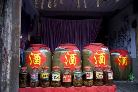 the local characteristics: Sichuan, China - February 17: A shop selling homemade liquor, containers filled with a variety of liquor sold, Chengdu, China, February 17, 2011