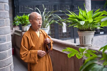 chanting: SICHUAN,CHINA-JULY 22,2010: unknown monk in the temple, chanting, July 22, 2010, shot in Chengdu, Sichuan Province, China Editorial
