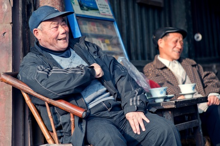 relocated: CHENGDU-JANUARY 24, 2010: The unnamed elderly in an old teahouse tea, this tea house will be removed and relocated due to urban renewal, the elderly can not come here to drink tea. January 24, 2010, Chengdu, China
