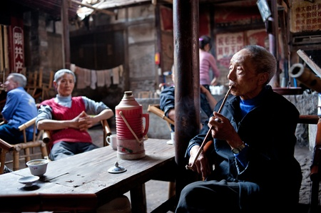 relocated: CHENGDU-APRIL 24, 2011: The unnamed elderly in an old teahouse tea, this tea house will be removed and relocated due to urban renewal, the elderly can not come here to drink tea. April 24, 2011, Chengdu, China Editorial