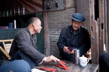 tea house: CHENGDU-APRIL 24, 2011: The unnamed elderly in an old teahouse tea, this tea house will be removed and relocated due to urban renewal, the elderly can not come here to drink tea. April 24, 2011, Chengdu, China Editorial