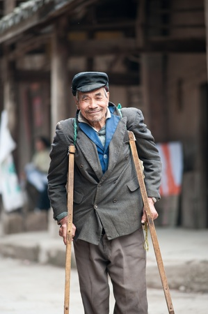 SICHUAN,CHINA-APRIL 4,2010:Nameless disabled elderly living alone, unattended, his sons and daughters working in the field, Sichuan, China, April 4, 2010