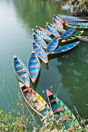Bright colored wooden boats in Pokhara photo