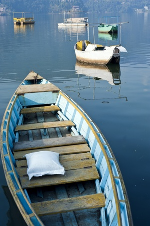 pokhara: Bright colored wooden boats in Pokhara