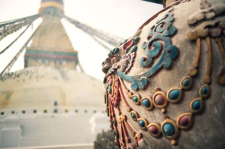 Prayer flags fluttering from the largest stupa in Nepal, which sits amid a significant Buddhist population
