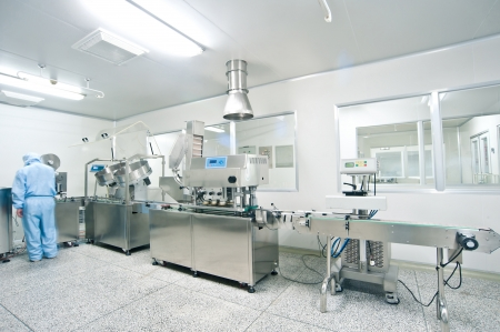 laboratory glass: Technicians working in the pharmaceutical production line Editorial