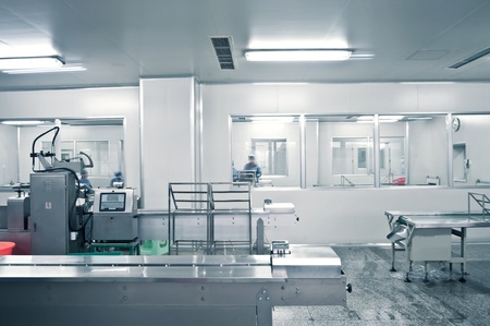 Technicians working in the pharmaceutical production line Editorial
