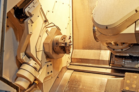Workers in the operation of CNC machine tools Stock Photo - 13047239