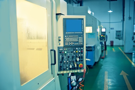 Workers in the operation of CNC machine tools Stock Photo - 13047249