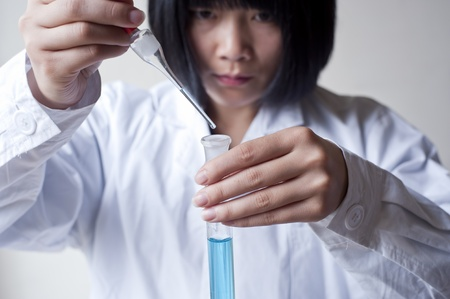 Female workers doing the experiment Stock Photo - 13086036