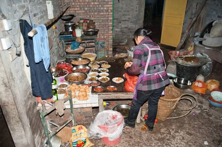 Sichuan, China -22 January, 2012, unknown women and men at home to prepare festive food, Sichuan, China, 2012 January 22, Stock Photo - 13436966