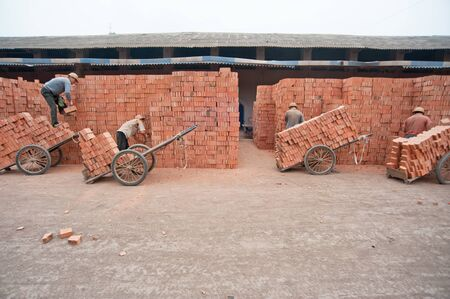 Sichuan, China in January -15 No  2012  unknown workers at the brick work, the local hundreds of small brick factory  Sichuan, China, January 15, 2012 Stock Photo - 13436940