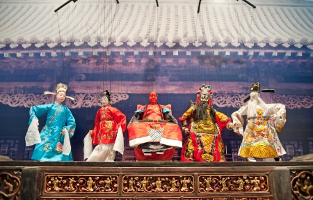 Human sculptures in the puppet theater, Made in China