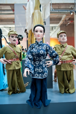 Human sculptures in the puppet theater, Made in China Stock Photo - 13956640