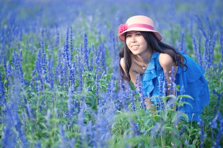 A Chinese young women playing in the vast lavender photo