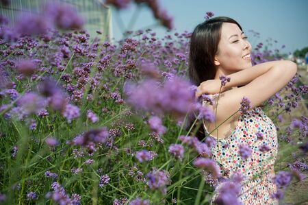 A Chinese young women playing in the vast lavender Stock Photo