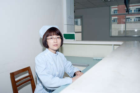 Nurse standing hospital reception desk photo