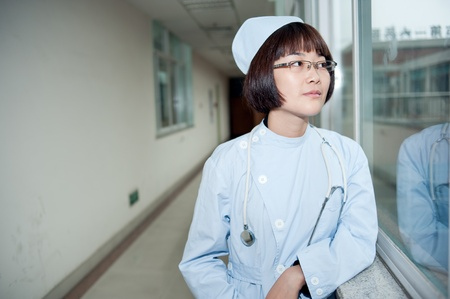 passageways: Smiling nurse at work