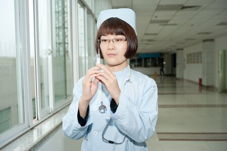 Smiling nurse in an injection photo