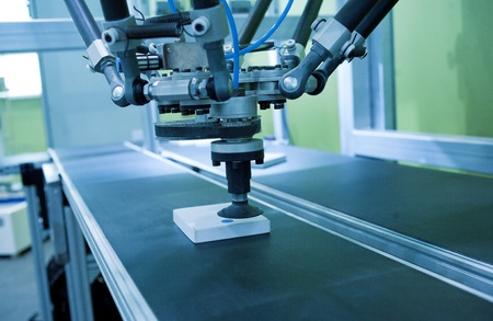 conveyors: The robot hand Stock Photo