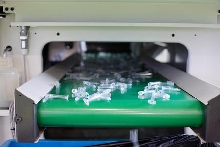Syringe production equipment Stock Photo