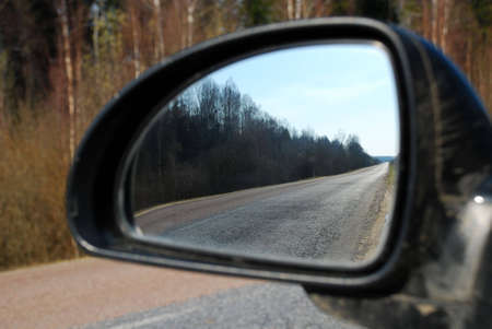 guardrails: photographed rear view mirror from a moving car. Stock Photo