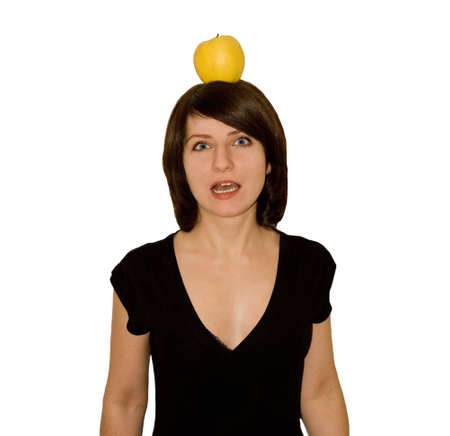The scared girl in a black dress with a yellow apple on a head