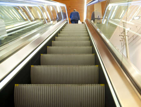 escalator, stairway, up, upwards, man, person, businessman, contrast Stock Photo