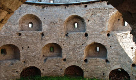 loopholes: Old medieval wall with loopholes, Pskov, Russia Stock Photo