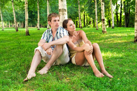 this photo shows a young couple in a birch grove photo