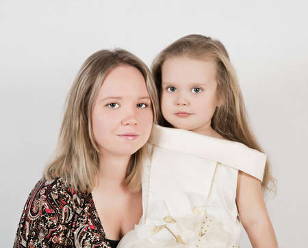 beautiful young mother and her three year old daughter at studio photo