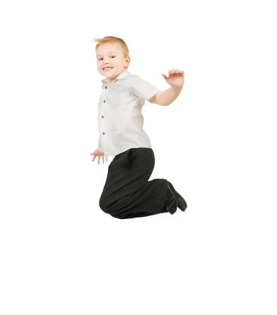 Adorable child jumping proudly a over white background Stock Photo