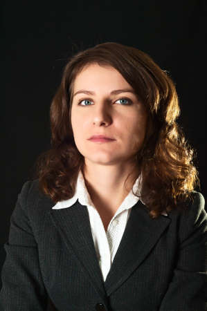 Portrait of women in business suit and white shirt on a black background Stock Photo - 8634529