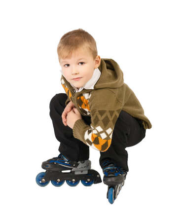little beautiful baby boy on roller skates photo