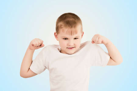 Child showing the muscle of his arm photo