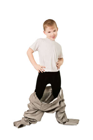 This photograph shows a boy in fathers trousers photo