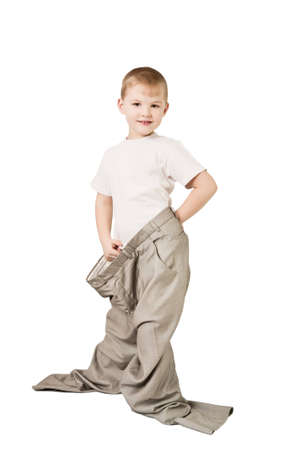 This photograph shows a boy in father's trousers Stock Photo - 10199345