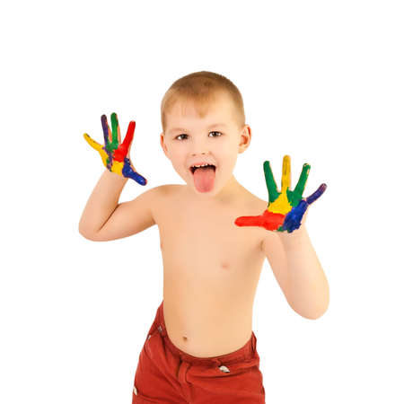 3 year old boy: Adorable 3 year old boy covered in bright paint Stock Photo