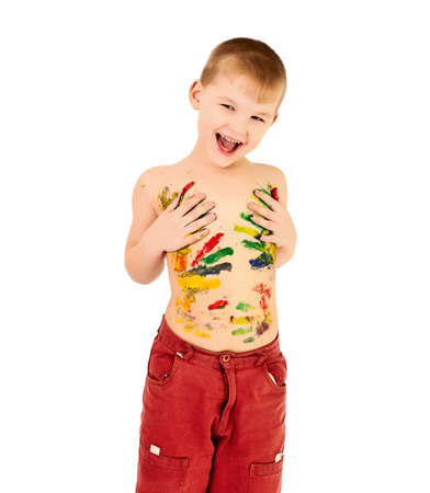 Adorable 3 year old boy covered in bright paint Stock Photo