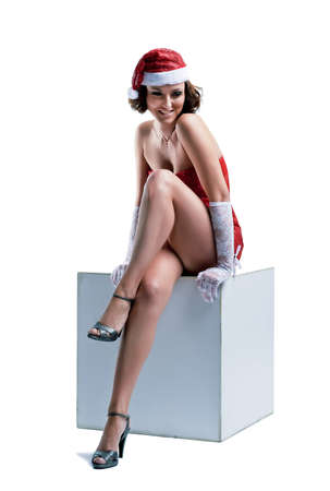 beautiful woman in a Santa Claus hat on white background