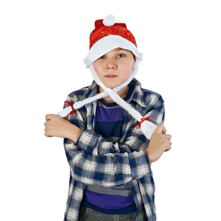 happy beautiful boy in the hat of Santa Claus on a white background