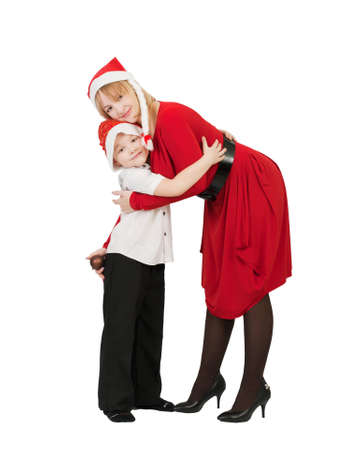 happy mother and son in Santa Claus hats