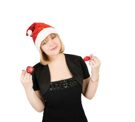 A girl in a black dress and hat of Santa Claus Stock Photo