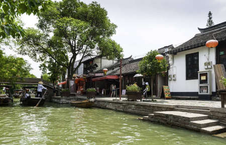 zhouzhuang: ZHOUZHUANG-AUGUST 19: Tourists make a trip by boat to the village on the water, on August 19,2012, Zhouzhuang, China