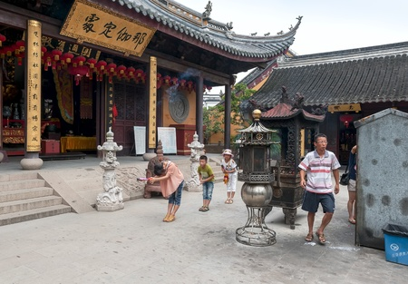 ZHOUZHUANG-AUGUST 19: The Chinese pray at a monastery in the village on the water , on August 19,2012, Zhouzhuang, China
