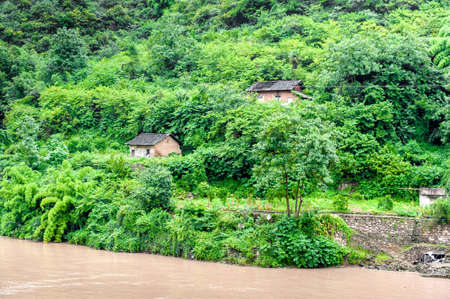 Travel by boat on the Yangtze River with views of the village Stock Photo